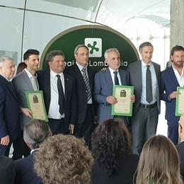 «Dall'Erbese un esempio per tutti»  Tre negozi storici premiati in Regione